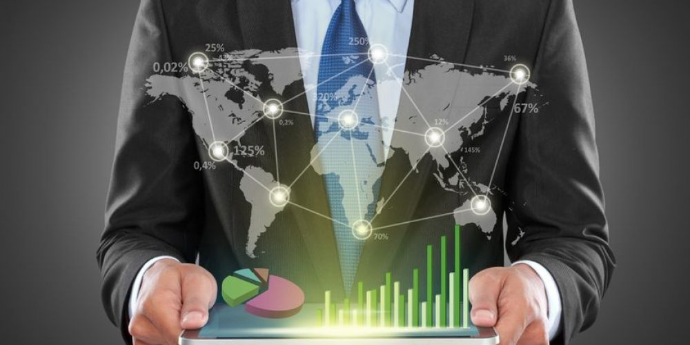 21747893 - portrait of success businessman with laptop showing social business connected
