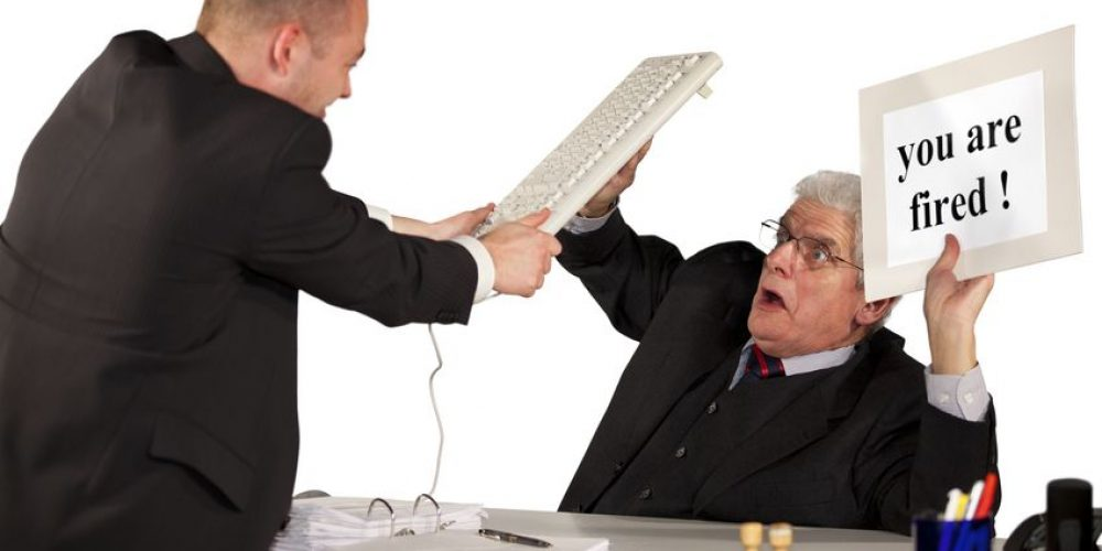 8860355 - a fired employee attacking his boss, a senior manager, with a keyboard