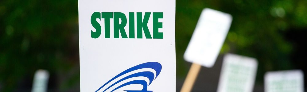people-rallying-carrying-on-strike-signage-1094323