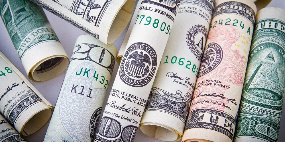 rolled-20-u-s-dollar-bill-164527